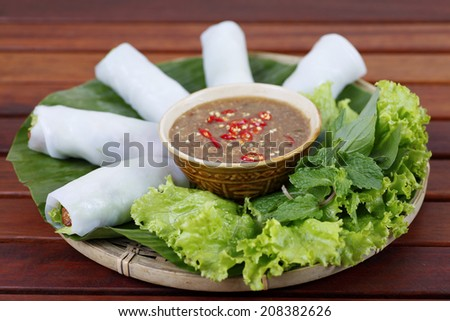 BI CUON - Wrapped rolls ( with boiled pork, shrimp, garlic chives) served with soy sauce, typical appetizer Vietnamese food. - stock photo