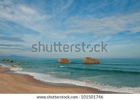 Biarritz beach, rocks and blue ocean, Aquitaine, France. - stock photo