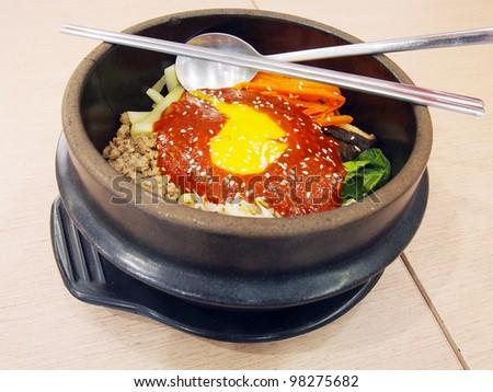 bibimbap in a heated stone bowl, korean dish - stock photo