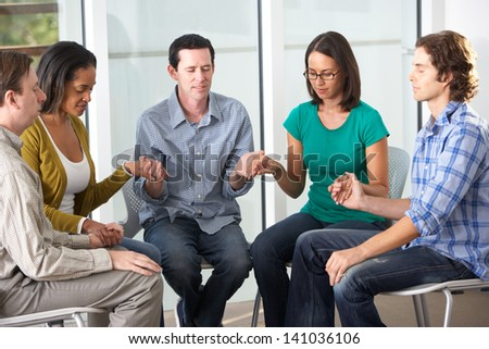 Bible Group Praying Together - stock photo