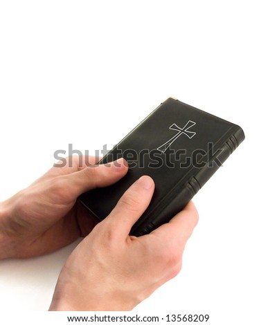 Bible in hands - stock photo