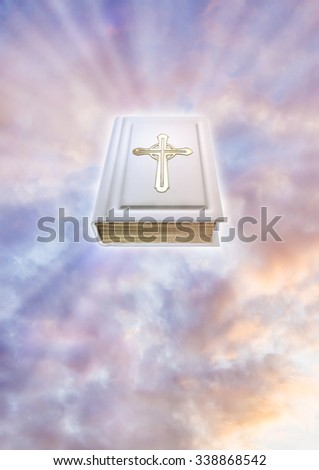 Bible in the sky / 3D render of white bible against heavenly sky - stock photo