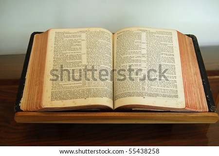 Bible lying open on stand - stock photo
