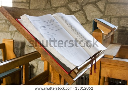bible open in a church ready for service - stock photo