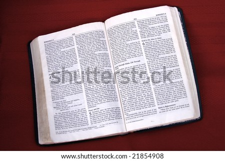 Bible opened to the book of Romans.