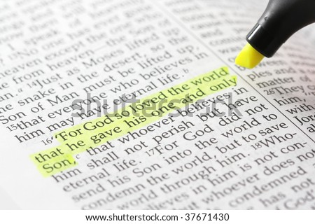 Bible passage with john 3:16 highlighted in yellow, with highlighter pen partially in frame - stock photo