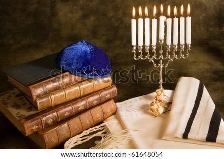 Bible, prayer shawl, jewish cap and nine candle menorah - stock photo