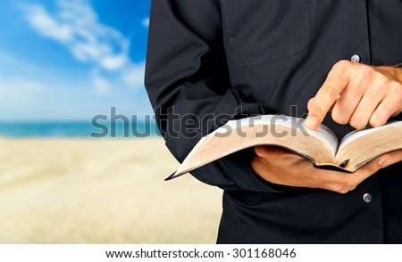 Bible, Priest, Preacher. - stock photo