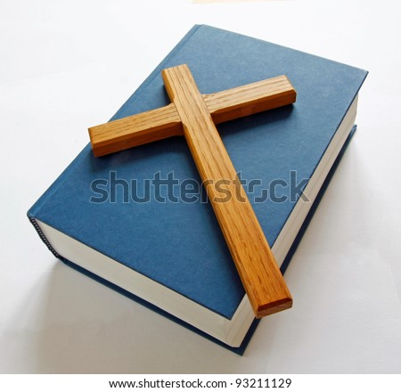 Bible with wooden cross - stock photo