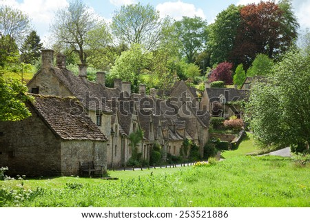Bibury. Arlington Row: Cotswold stone cottages  in beautiful spring day. England, UK. - stock photo