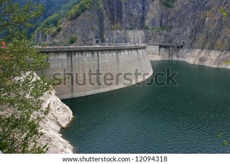 Bicaz Dam holding an artificial lake, Romania - stock photo
