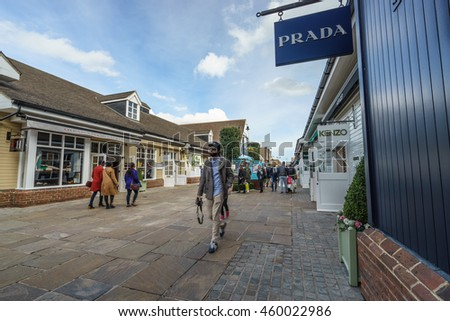 BICESTER, ENGLAND - JULY 5, 2016. Prada shop at Bicester Village. Bicester Village is an outlet shopping centre on the outskirts of Bicester, a town in Oxfordshire