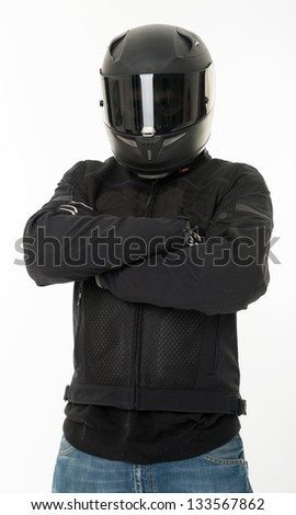 Bicker in black wearing his crash helmet - stock photo