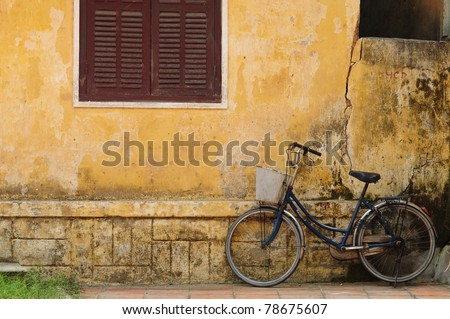 Bicycle and old house in Hoi an, Vietnam - stock photo