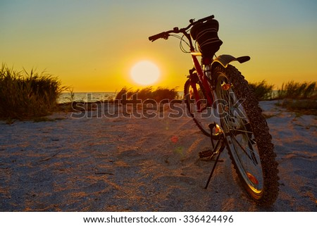 Bicycle at the beach on twilight time - stock photo