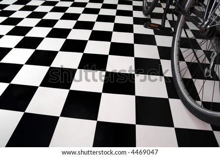 Bicycle close up and black and white floor - stock photo