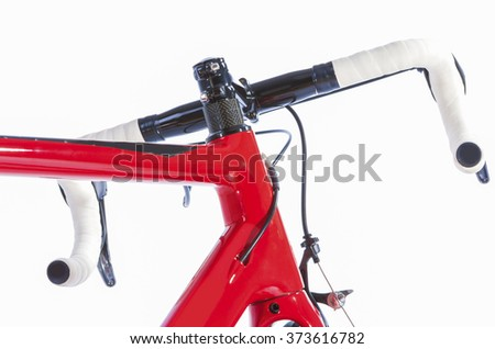 Bicycle Concept. Partial View of Professional Road Bike Handlebars With White Grip Tape. Against White. Horizontal Image Composition - stock photo