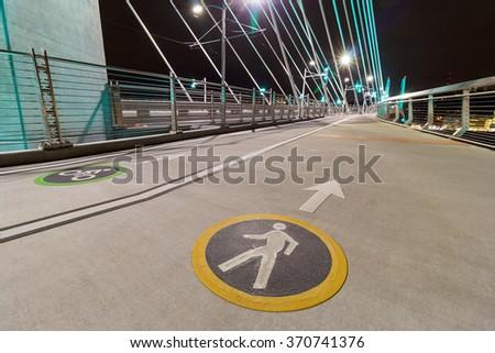 Bicycle Cyclist and Pedestrian Lane Signs on Tilikum Crossing Bridge in Portland Oregon - stock photo