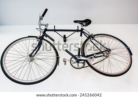 bicycle fixed gear on white wall - stock photo