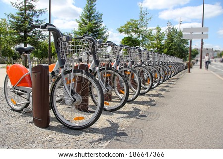 Bicycle for rent in the city, public transportation - stock photo