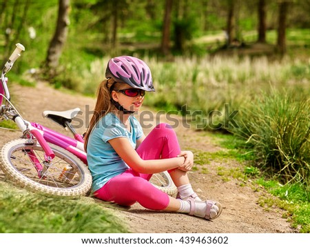 Bicycle girl. Girl rides bicycle. Girl in bicycle sitting near bicycle. Bicycle is good for health and mood. Bicycle girl looking into distance. - stock photo