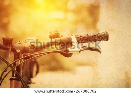 Bicycle handle bar close up. Vintage filter - stock photo