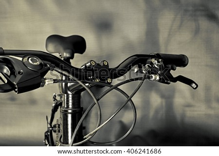 Bicycle Handlebars, brake levers, shifters, seat and cables - stock photo