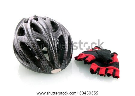 Bicycle helm with cycle gloves isolated on white background - stock photo