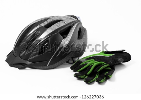 bicycle helmet and gloves on a white background - stock photo