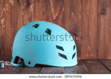 Bicycle helmet on a red background old wood.
