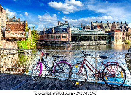 Bicycle is very common and popular transport in cities of Europe. Bicycles in european town street. Ghent, Belghium - stock photo