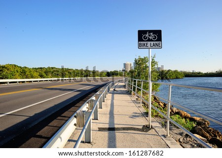 Bicycle lane along the road in the suburb area West Palm Beach, Florida, USA - stock photo
