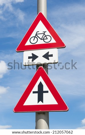 bicycle lane crossing a priority road, warned by traffic signs - stock photo