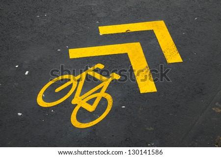 Bicycle lane sign on asphalt surface - stock photo
