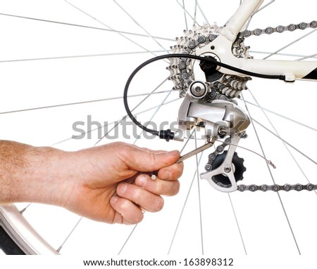 Bicycle Maintenance- adjusting the rear derailer on a road bike - stock photo