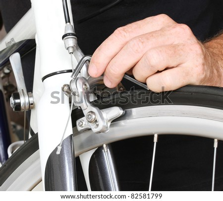Bicycle maintenance. Fixing the breaks on a road bike. - stock photo