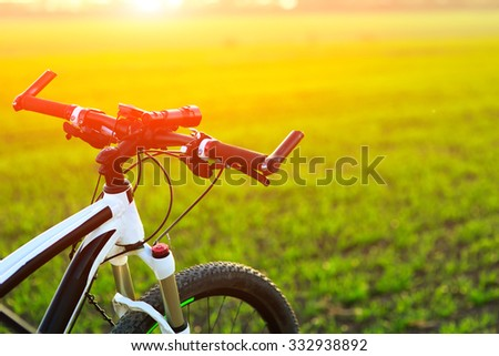 bicycle on a road against sunset. travel concept