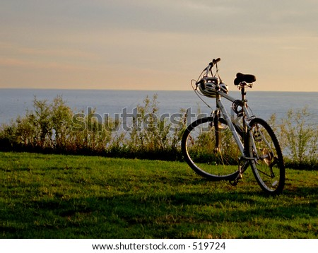 Bicycle on lakeshore - stock photo