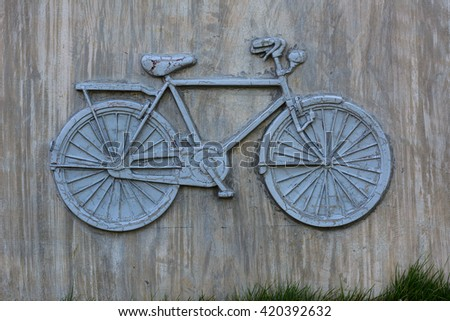 bicycle on the wall. - stock photo