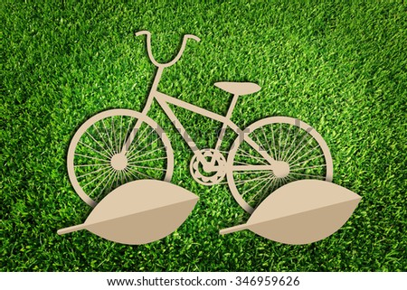 bicycle. Paper cut of eco on green grass. - stock photo