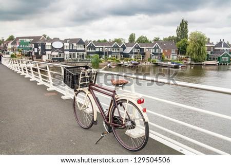 Bicycle parked on bridge, Zaanse Schans - stock photo