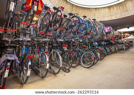 """Bicycle parking garage on Groningen Central. The city of Groningen has been elected """" most cycling friendly city of the Netherlands"""" for 3 years in a row. - stock photo"""