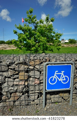 Bicycle parking sign on Bornholm island, Denmark - stock photo