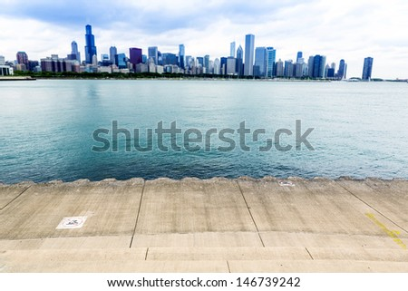 Bicycle Path in City Downtown With Dramatic Sky - stock photo