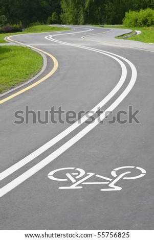 bicycle path with white sign in the park - stock photo