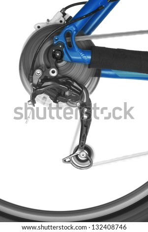 bicycle rear derailleur and wheel in motion - stock photo