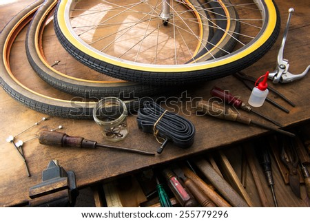 Bicycle repair. Repairing or changing a tire, tire tubes and brakes wires of an vintage bicycle. - stock photo