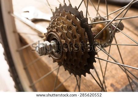 Bicycle repair. sprocket section of a bicycle. Repairing or a rear wheel of a bicycle. - stock photo