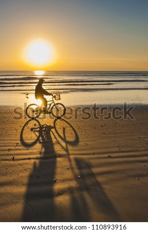 Bicycle Ride at Sunrise on Cocoa Beach - stock photo