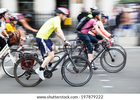 bicycle rider on a city street in motion blur - stock photo